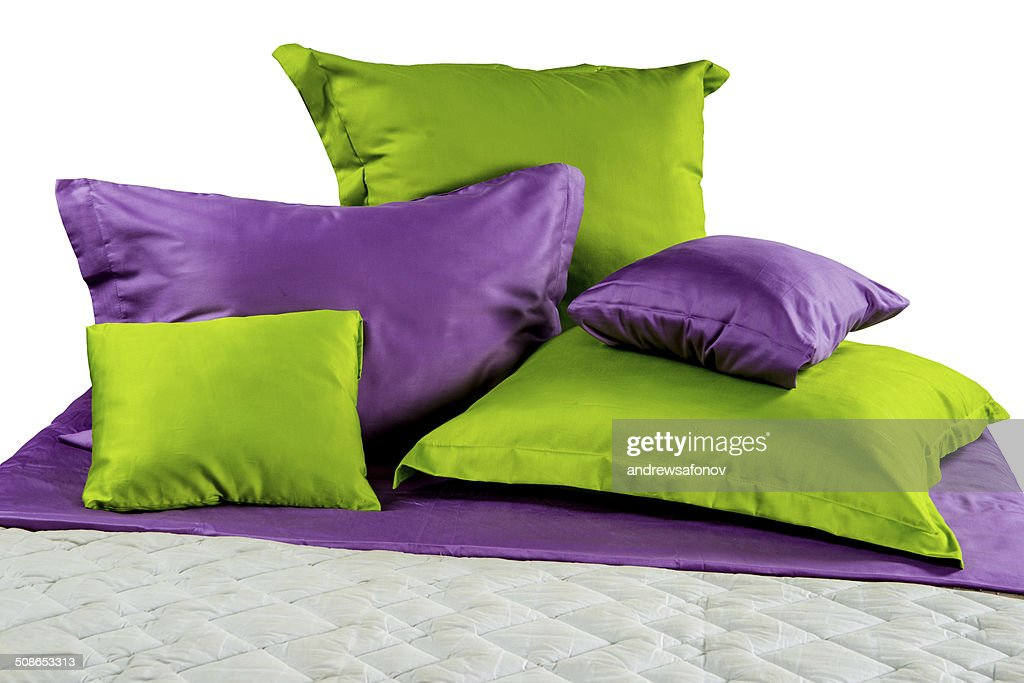 set of colorful pillows and blankets on bed : Stock Photo