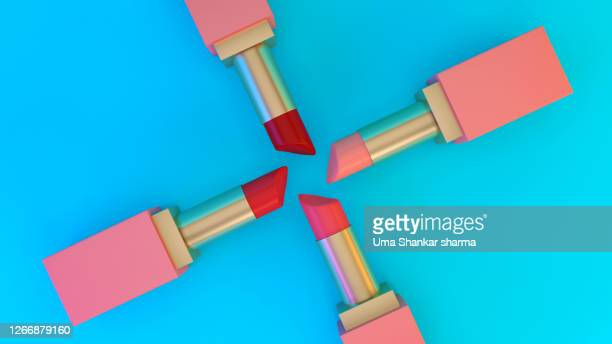 set of colourful lipsticks placed circularly on a cyan background. 3d render of lipsticks for advertising. - batom rosa - fotografias e filmes do acervo