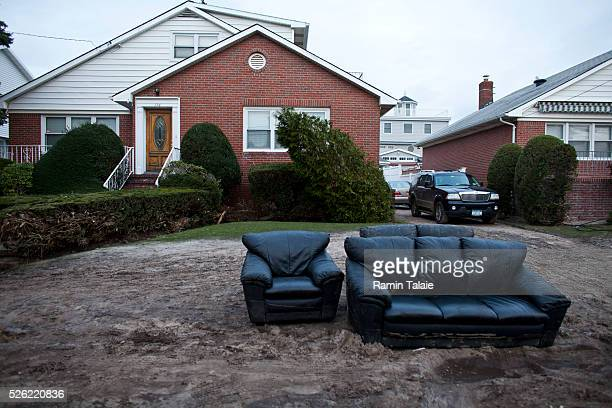 A set of couches damaged from flooding are placed on the curb in the aftermath of Hurricane Sandy in Belle Harbor section of Queens in New York...