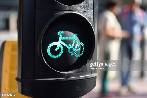 A set of cycle traffic lights shows a green light on the EastWest Cycle Superhighway near Tower Hill on August 28 2017 in London England