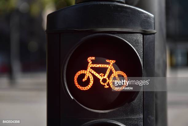 A set of cycle traffic lights shows a red stop light on the EastWest Cycle Superhighway near Tower Hill on August 28 2017 in London England