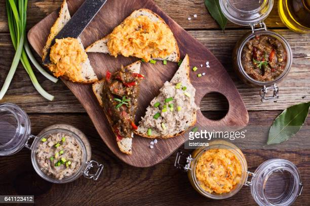 Set of different homemade vegetable and bean pastes, sandwiches with vegan pate
