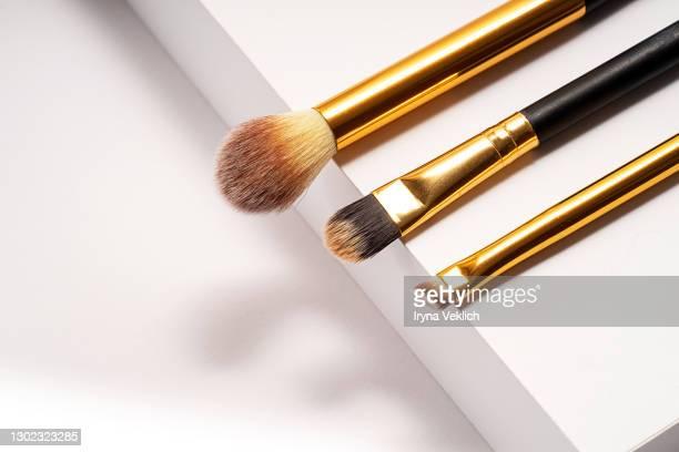 set of different makeup brushes on white podium background - メイクアップブラシ ストックフォトと画像