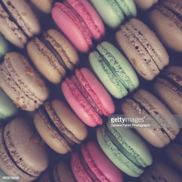 set of different pastel colored macaroons - samere fahim stock photos and pictures