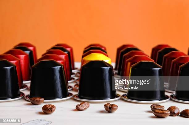 set of espresso coffee capsules for machine - space capsule stock photos and pictures