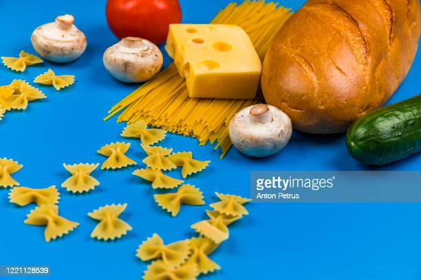 set of food on a blue background. food donation - poor service delivery stock pictures, royalty-free photos & images