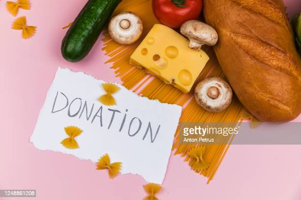 set of food on a pink background. food donation - poor service delivery stock pictures, royalty-free photos & images