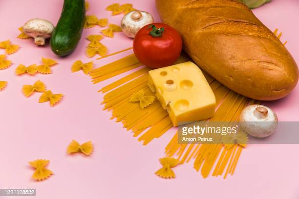 set of food on a pinkbackground. food donation - poor service delivery stock pictures, royalty-free photos & images