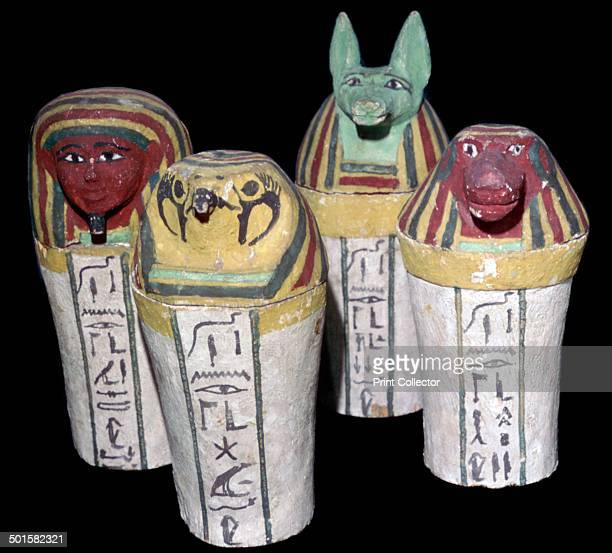 Set of four canopic jars for the storage of organs the heads representing the four sons of Horus