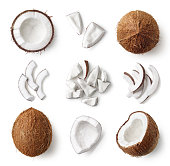 Set of fresh whole and half coconut and slices