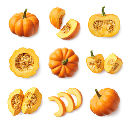 Set of fresh whole and sliced pumpkin 1057881940