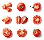 Set of fresh whole and sliced tomatoes
