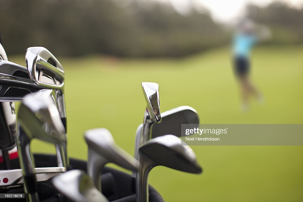 A set of golf clubs on the green : Stock Photo