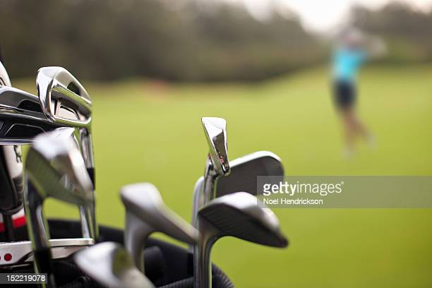 A set of golf clubs on the green