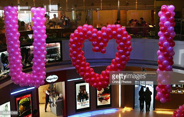 A set of 'I love you' shaped decoration with balloons is seen in a cinema on Valentine's Day February 14 2006 in Beijing China Valentine's Day is...