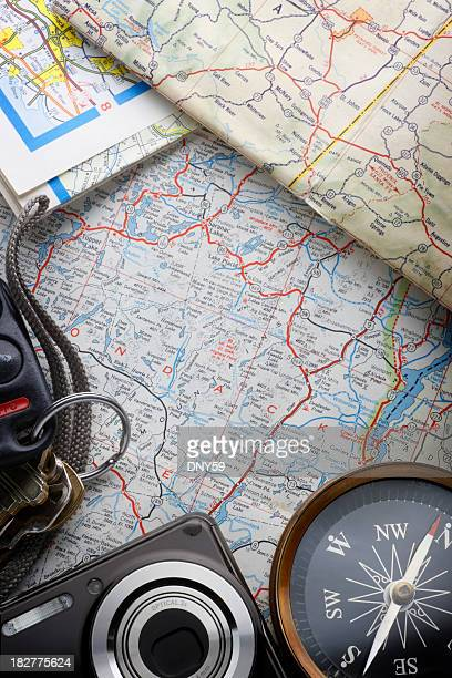Set Of Keys,Camera, And A Compass On A Road map
