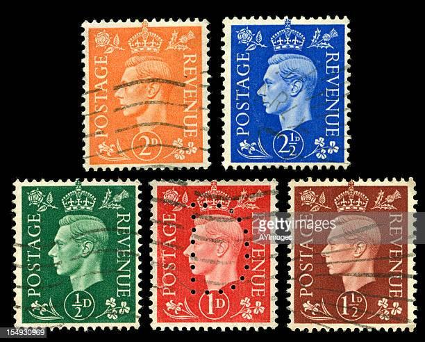 Set of King George VI stamps on black background