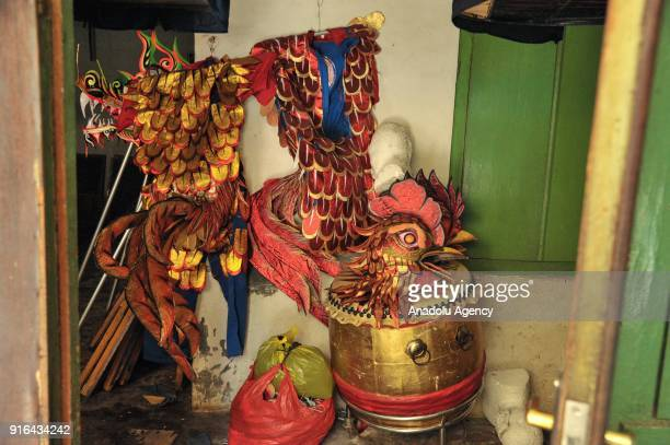 A set of Liong costume with last year Imlek icon chicken at home industry costume maker in Bogor Indonesia on February 9 2018 The Liong and Barongsai...