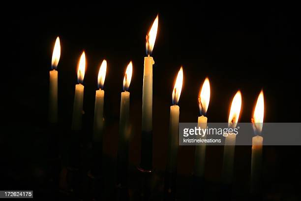 set of lit menorah candles in the dark - candle in the dark stock pictures, royalty-free photos & images