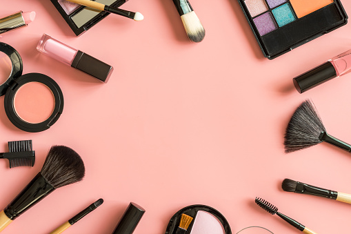 Set of make up brushes and cosmetics on pink background 914741860