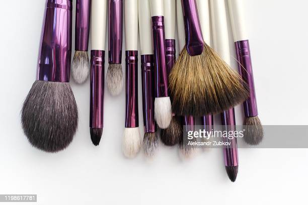 set of makeup artist brushes for professional makeup in a beauty salon, on a white background. the concept of cosmetics, body and face care. - 舞台化粧 ストックフォトと画像