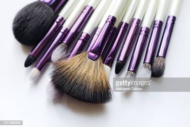 a set of makeup artist brushes for professional makeup in the beauty salon and at home, on a white background. the concept of cosmetics, body and face care. - メイクアップブラシ ストックフォトと画像