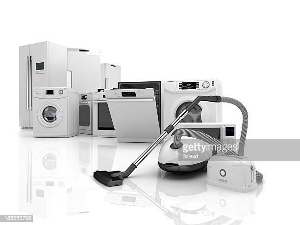 Set of matching home appliances on reflective surface