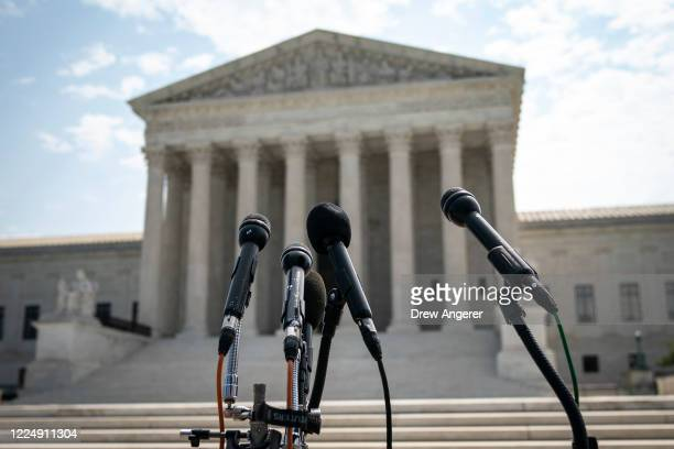 Set of microphones stand outside of the U.S. Supreme Court on July 6, 2020 in Washington, DC. The Supreme Court issued a unanimous opinion on Monday...