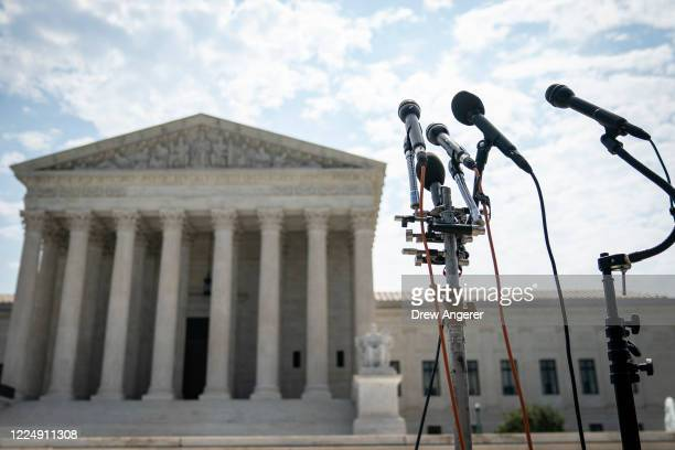 A set of microphones stand outside of the US Supreme Court on July 6 2020 in Washington DC The Supreme Court issued a unanimous opinion on Monday...