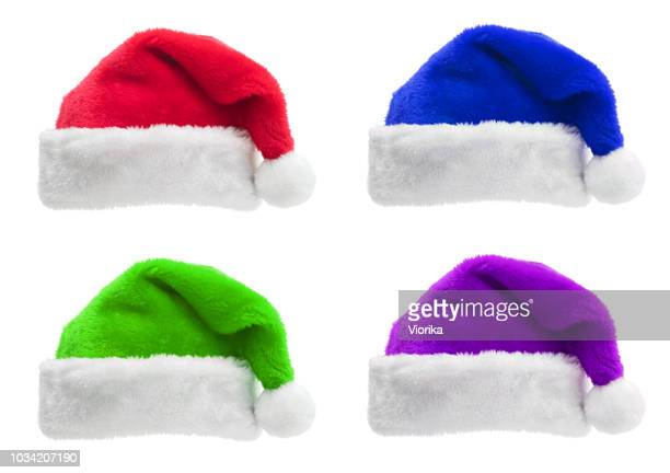 set of multi colored santa hats isolated on a white background - green hat stock pictures, royalty-free photos & images