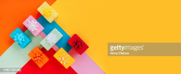 set of multicolored present boxes on colorful background - holiday stock pictures, royalty-free photos & images