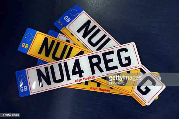 A set of new 2014 vehicle license registration plates are seen ready to be attached to automobiles at a Nissan Motor Co new car showroom in Romford...