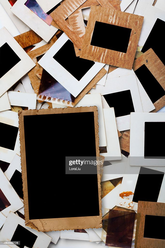 Set of old slides, photos and film on the table : Stock Photo