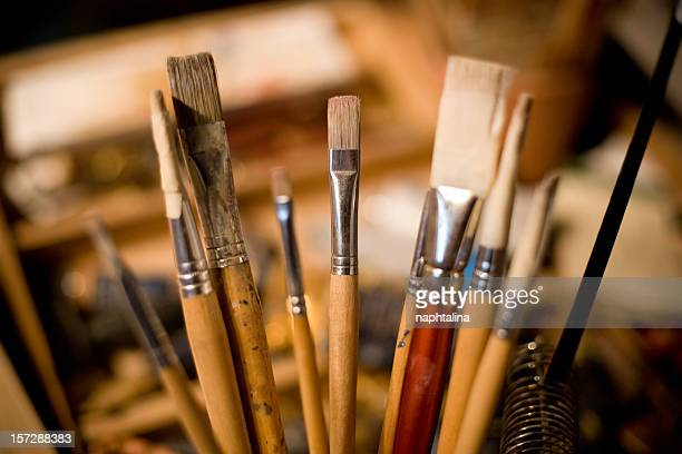 A set of paintbrushes in an artists studio