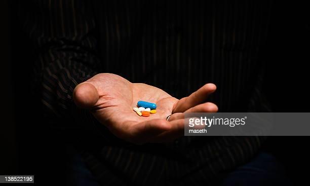 Set of pills lying on palm