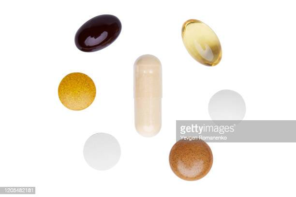 set of pills on white background - pills stock pictures, royalty-free photos & images