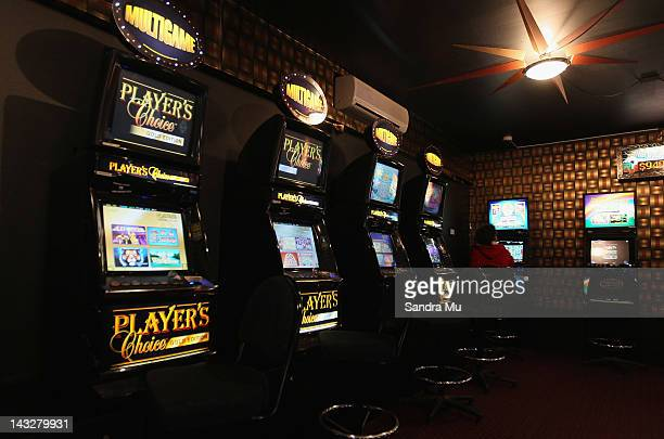 A set of poker machines are seen on April 23 2012 in Auckland New Zealand The Government is supporting a deal with the SkyCity casino whereby the...