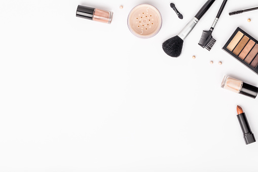 set of professional decorative cosmetics, makeup tools and accessory on white background with copy space for text. beauty, fashion, party and shopping concept. flat lay composition, top view 944152208