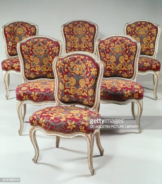 Set of six Louis XV style chairs with curved back in molded wood with ribs lacquered creamcolored arched legs Mayeux logo 86x55x48cm France 18th...