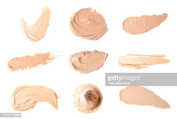 set of smears of liquid powder, cosmetic make up beige liquid foundation smudges range of colors on white background. - off white stock pictures, royalty-free photos & images