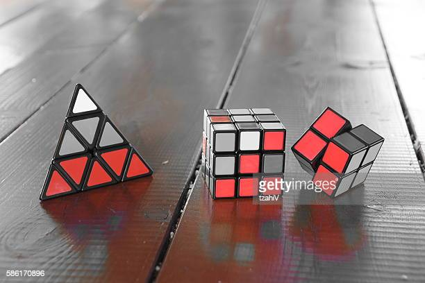 set of three rubiks cube - triangle percussion instrument stock photos and pictures