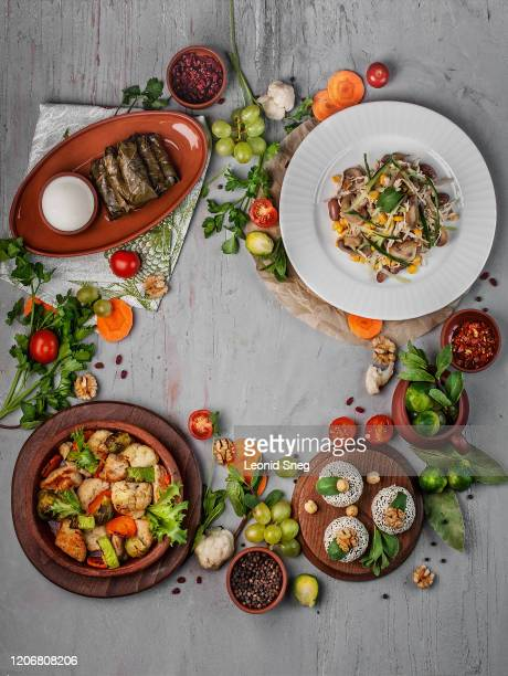 set of traditional national georgian dishes and spices, top view on gray textural background - georgian culture stock pictures, royalty-free photos & images