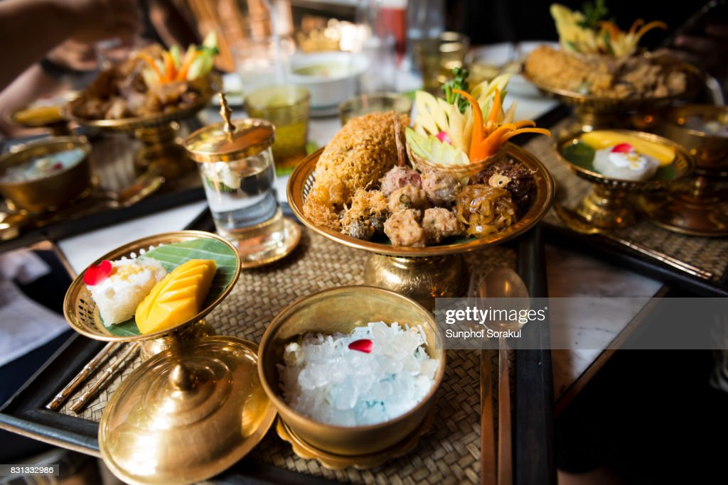 A set of Traditional Thai food Khao Chae on brass bowls and platters : Stock Photo