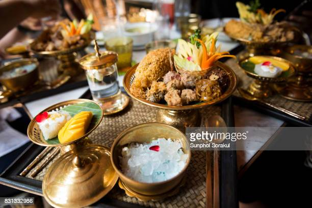 a set of traditional thai food khao chae on brass bowls and platters - thai food stock pictures, royalty-free photos & images