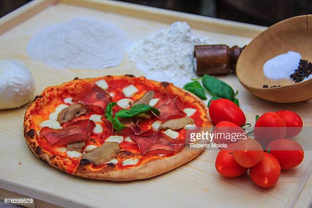 Set of typical Italian products of Bresaola of Valtellina, pizza with mushrooms, tomatoes from Sicily, mozzarella from Naples, Italy, Europe