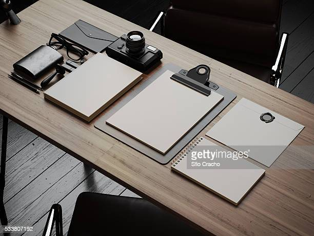 Set of white branding elements at the workspace. 3d render