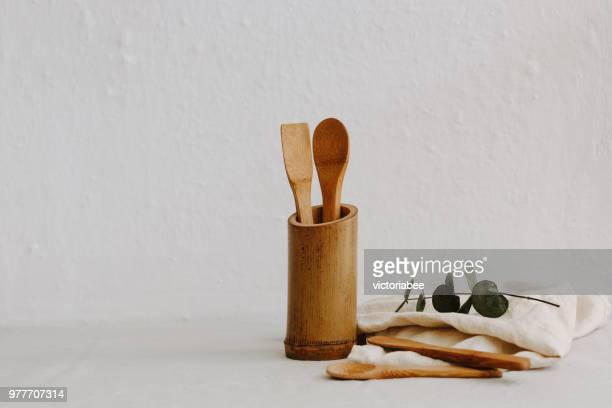 set of wooden kitchen utensils, linen napkin and eucalyptus - keukengereedschap stockfoto's en -beelden