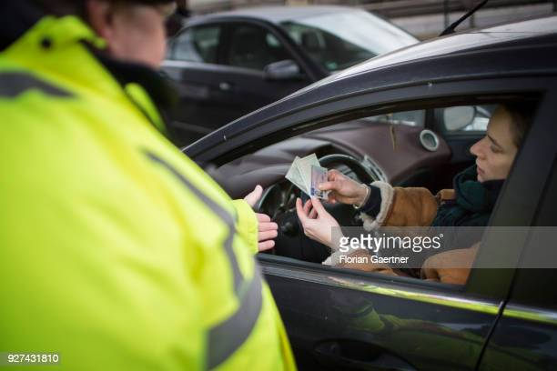 Set scene during a traffic control in Berlin A young woman is stopped by the police and has to show her papers on February 27 2018 in Berlin Germany