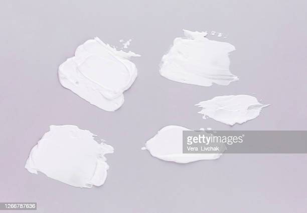 set smear of natural moisturizer in grey background. cream, lotion for face or body. skin care. - face mask beauty product stock pictures, royalty-free photos & images