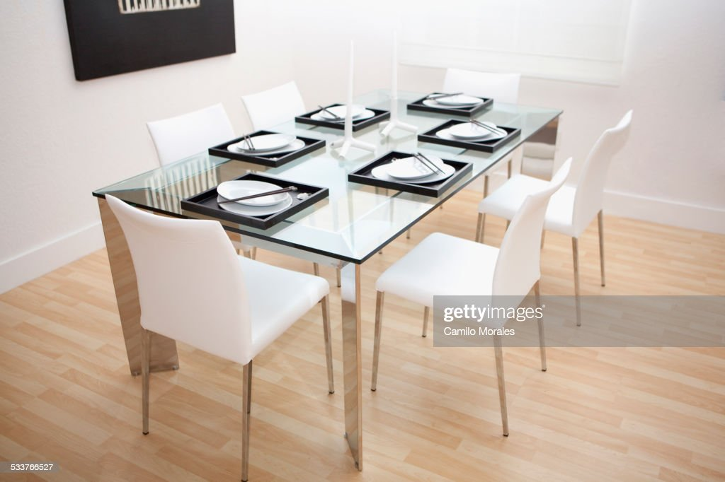 Set table and chairs in modern dining room : Foto stock